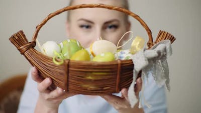 Happy Easter - Woman Holding Easter Basket with Easter Eggs