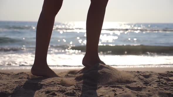 Thumbnail for Female Feet Walking at the Sea Beach on a Sunny Day with Waves at Background. Legs of Young Woman