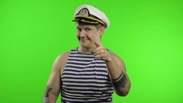 Thumbnail for Young Sailor Man Shows Muscles, Looking at Camera. Seaman Guy in Sailor's Vest