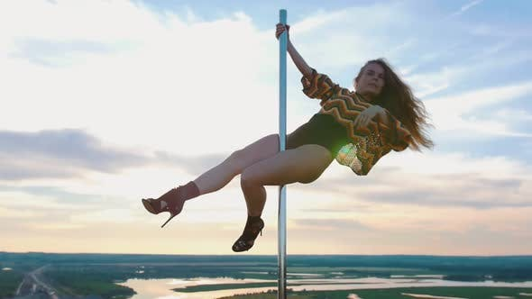 Thumbnail for Pole Dance on Nature - Sexy Woman in Swimsuit Dancing on the Top of Dancing Pole