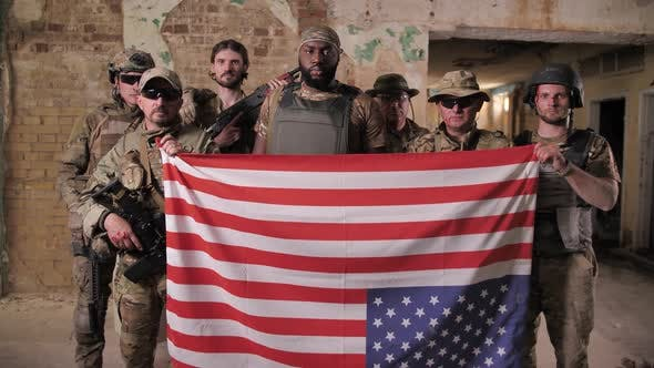 Thumbnail for Group of Soldiers Posing with USA Flag Upside Down