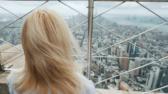 Cover Image for A Woman Looks Through the Bars on the Panorama of New York