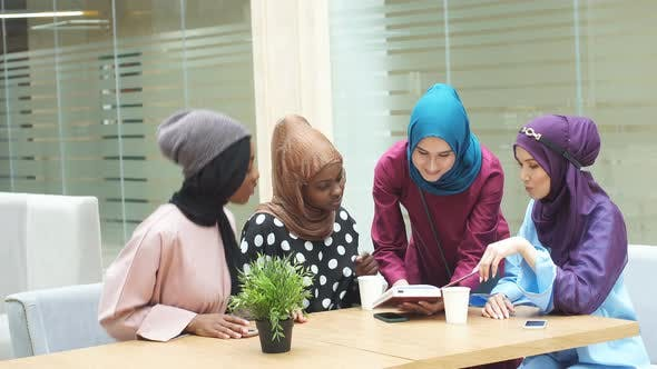 Thumbnail for Group of Muslim Young Women Shopping On-line, Using Laptop Computer