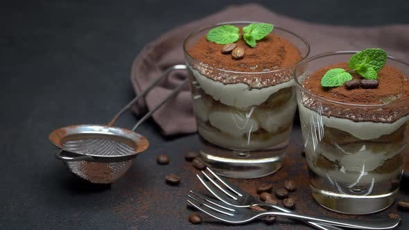Thumbnail for Two Portions Classic Tiramisu Dessert in a Glass on Dark Concrete Background