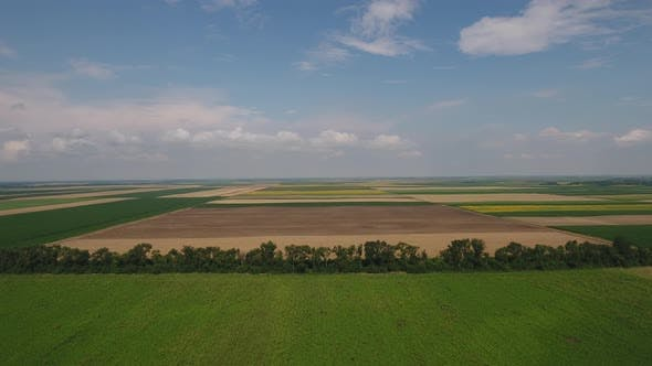 Aerial Shot Of Agricultural Fields In Spring