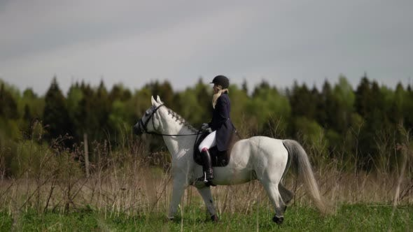 Young Woman is Riding on Horseback Professional Jockey is Training Preparing to Competition
