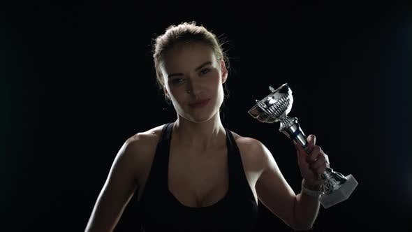 Thumbnail for Happy Woman Raising Up Hands with Champion Trophy in Slow Motion