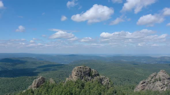 Aerial Hyperlapse of Rocky Peaks and Forest in the Siberian Nature Reserve Stolby