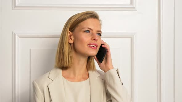 Thumbnail for Model Wearing Business Outfit while Talking over her Phone