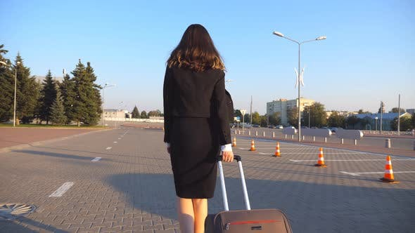 Thumbnail for Business Woman with Her Suitcase Going From Airport To Taxi Parking. Lady Walking with Her Luggage