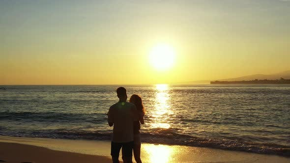 Thumbnail for Young couple married on vacation live the dream on beach on clean white sand background 4K