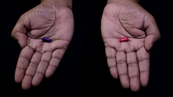 Thumbnail for Hands Offer Red or Blue Pill Choice
