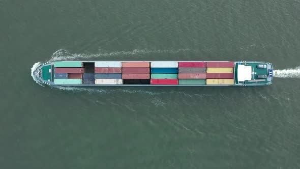 Bird's Eye View of a Cargo Shipping Container Ship at Sea