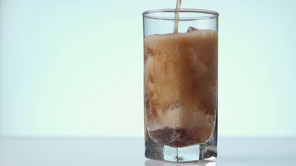 Thumbnail for Pouring Cola with Ice Cubes Close-up, Cola with Ice and Bubbles in Glass, Coke Soda