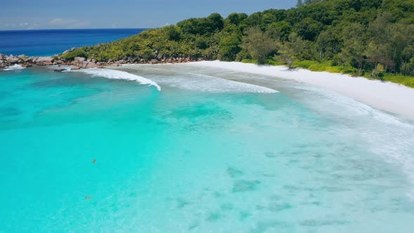 Thumbnail for Seychelles La Digue Island. Aerial Fly Above Blue Lagoon of Most Beautiful Tropical Beach Anse Cocos