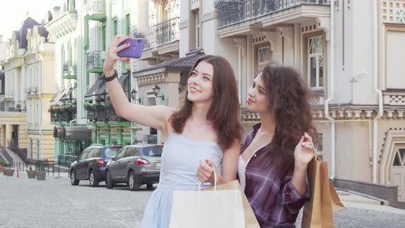 Thumbnail for Lovely Female Friends Taking Selfies on Smart Phone After Shopping