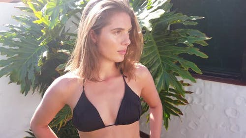 Pretty Female Model in Black Swimwear Smiling