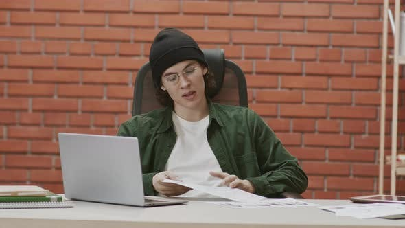 Young Male Designer Having Video Meeting with Client