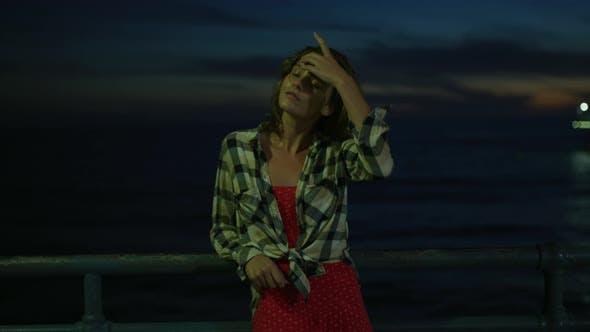 Thumbnail for Girl on Santa Monica Pier, at night