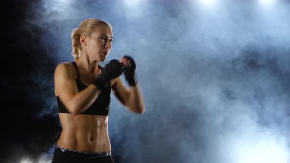 Thumbnail for Training Blows By Feet Strong Girl Boxer