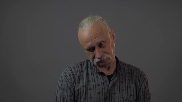 Thumbnail for Sad Grandfather with Grey Hair Shakes Head and Looks Down