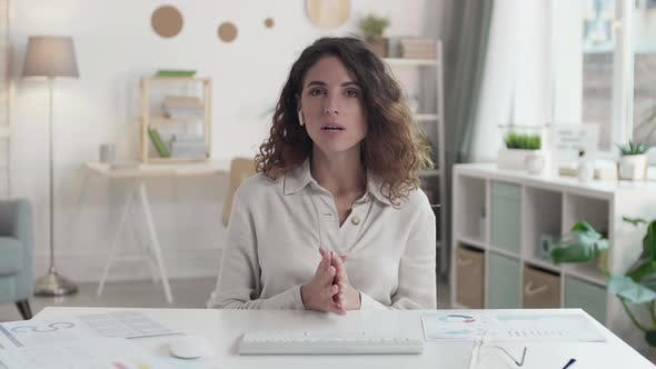 Businesswoman Presenting Charts Remotely