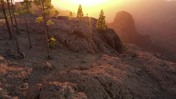 Thumbnail for Man Looking At Sunset Over Misty Mountain