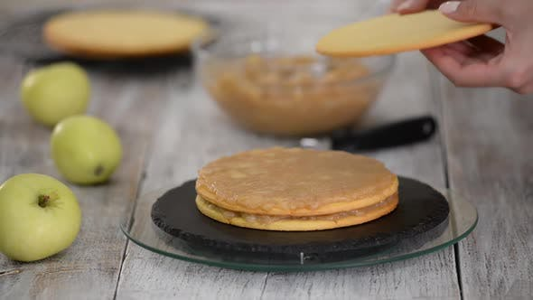 Thumbnail for Cook Making Layer Cake with Apple Filling.