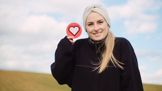 Woman Holding Heart Social Media Icon - Loving Agriculture