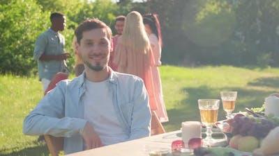 Caucasian Man Sitting At Table