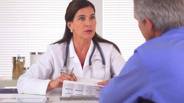 Thumbnail for Doctor reviewing medical history with patient