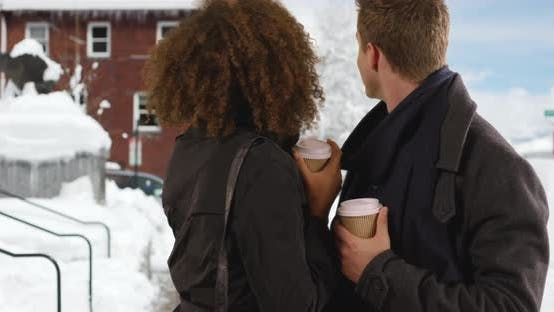 Thumbnail for Happy millennial couple drink coffee outside in the snow