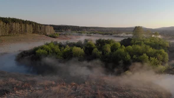 Thumbnail for Aerial View of Fog Over the River at Sunrise