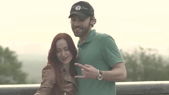 Thumbnail for Couple Makes Selfie on a Smartphone. Slow Motion