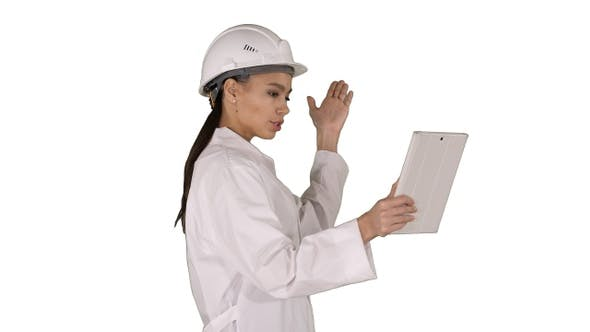 Thumbnail for Woman Engineer with Tablet Making Video Call on White Background