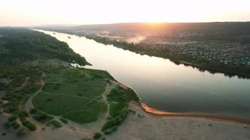 Aerial View, River Flows Between Two Banks, Sand Spit. Beautiful Nature Landscape, River Flood