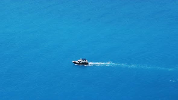 Thumbnail for Small Boat Quickly Floating on the Calm Water Surface and Leaving a Trail on the Sea.  Video