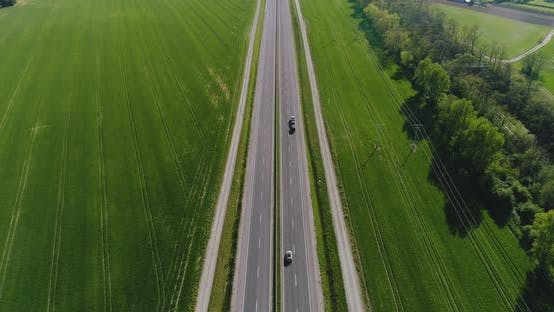 Thumbnail for Car Passing Highway Aerial View