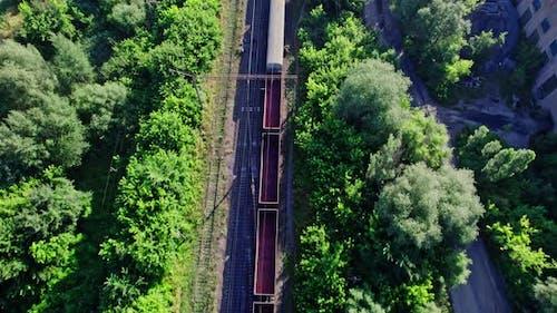 Locomotive with Freight Railway Wagon Rides on Railroad
