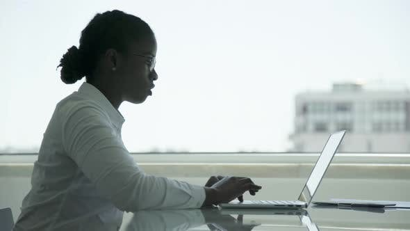 Thumbnail for African American Businesswoman Typing on Laptop