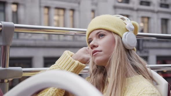 Thumbnail for Blond Teenage Tourist With Headphones On Bus