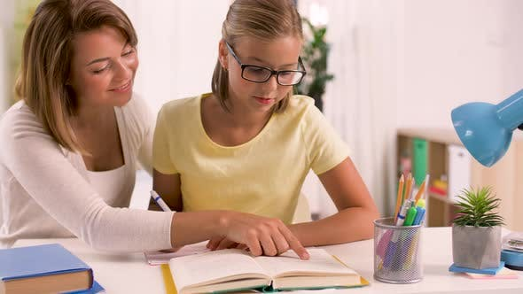 Thumbnail for Mother and Daughter Doing Homework Together