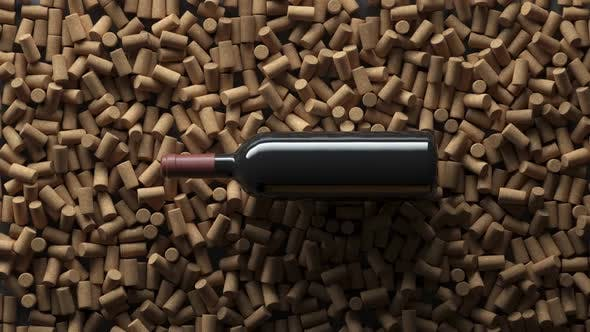 Top view crane shot of wine bottle over corks