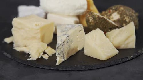 Various Types of Flavored Cheese on a Plate