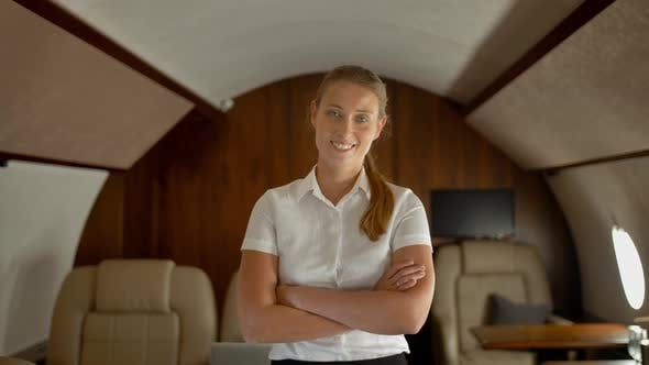 Thumbnail for Rich Business Lady Inside of Luxury Private Business Jet Smiling and Looking at Camera