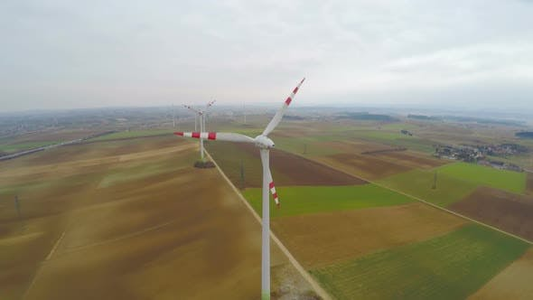 Thumbnail for Wind Turbines Rotating on Green Field. Alternative Source of Energy. Aerial View