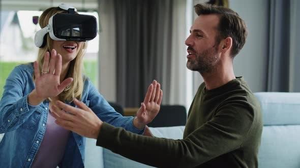 Thumbnail for Modern couple using virtual reality simulator