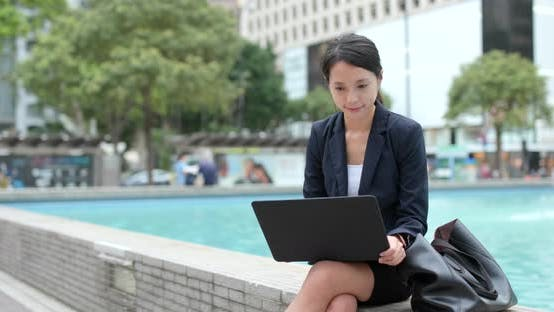 Thumbnail for Businesswoman work on laptop computer at outdoor