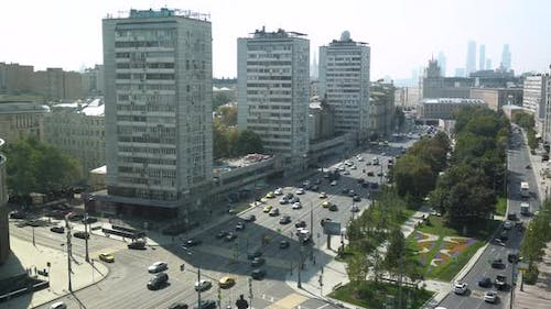 Cars Driving on the Moscow Road. View From Above. Around the Building and Alleria