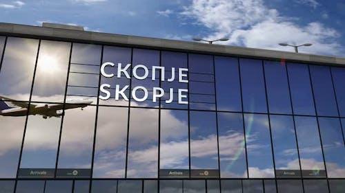 Airplane landing at Skopje Macedonia Macedonia airport mirrored in terminal